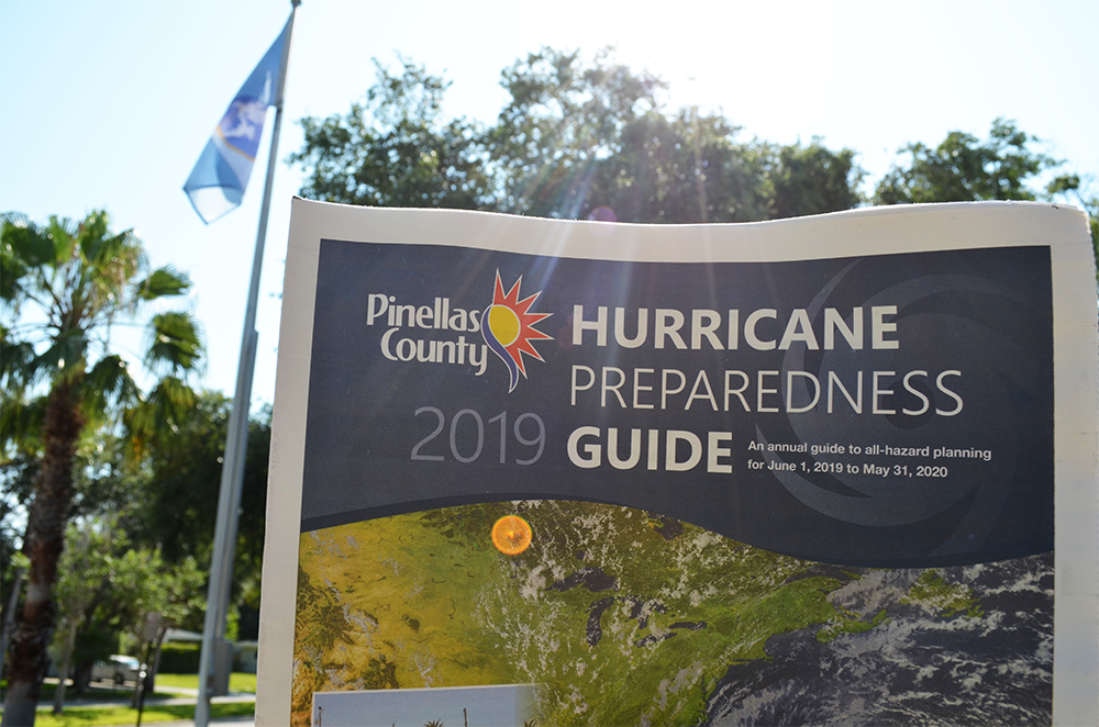 A copy of Pinellas County's 2019 Hurricane Preparedness Guide outside in front of Town Hall