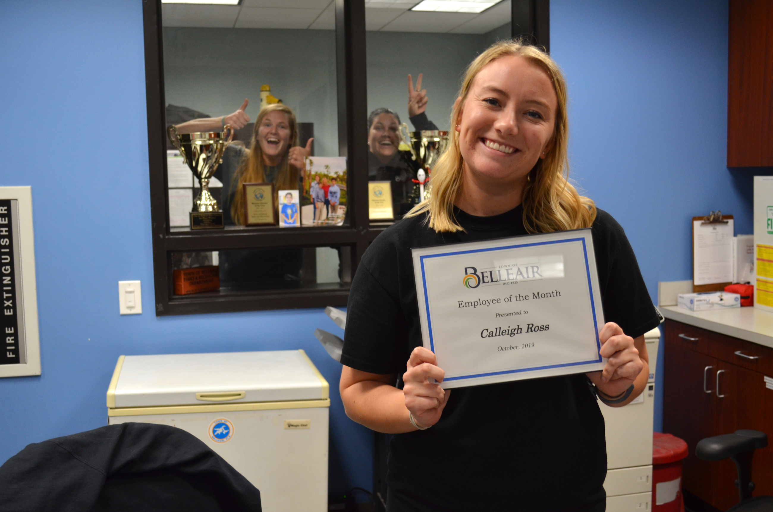 Calleigh Ross smiles with her Employee of the Month certificate at the Dimmitt Community Center fron