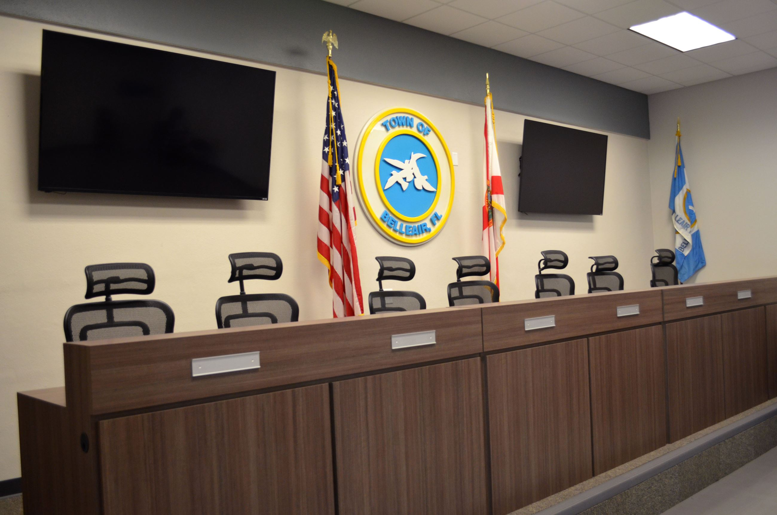 Belleair's Commission chambers include chairs on a raised dais underneath a Town of Belleair seal