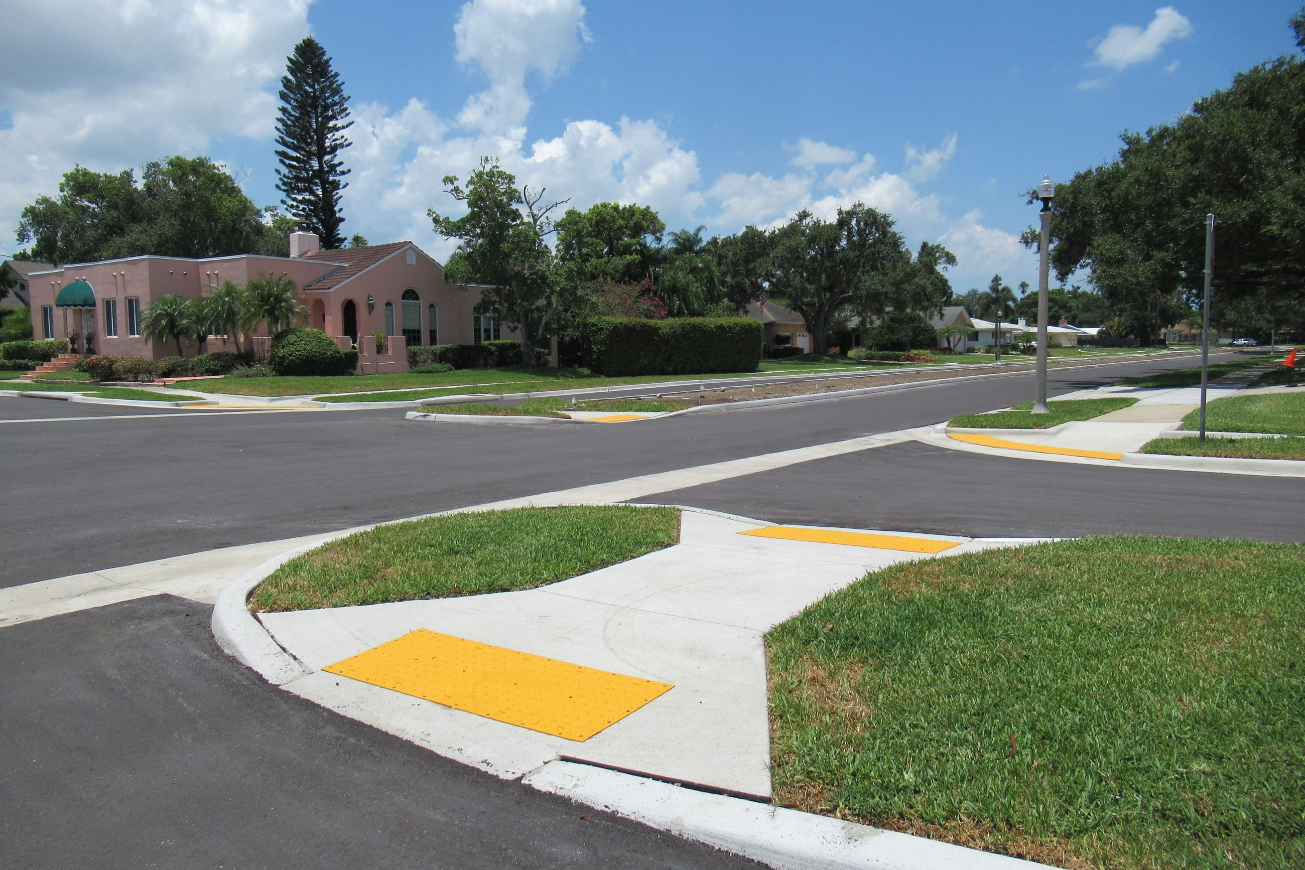 The Pinellas/Ponce Roadway Project near completion with fresh asphalt and sidewalk