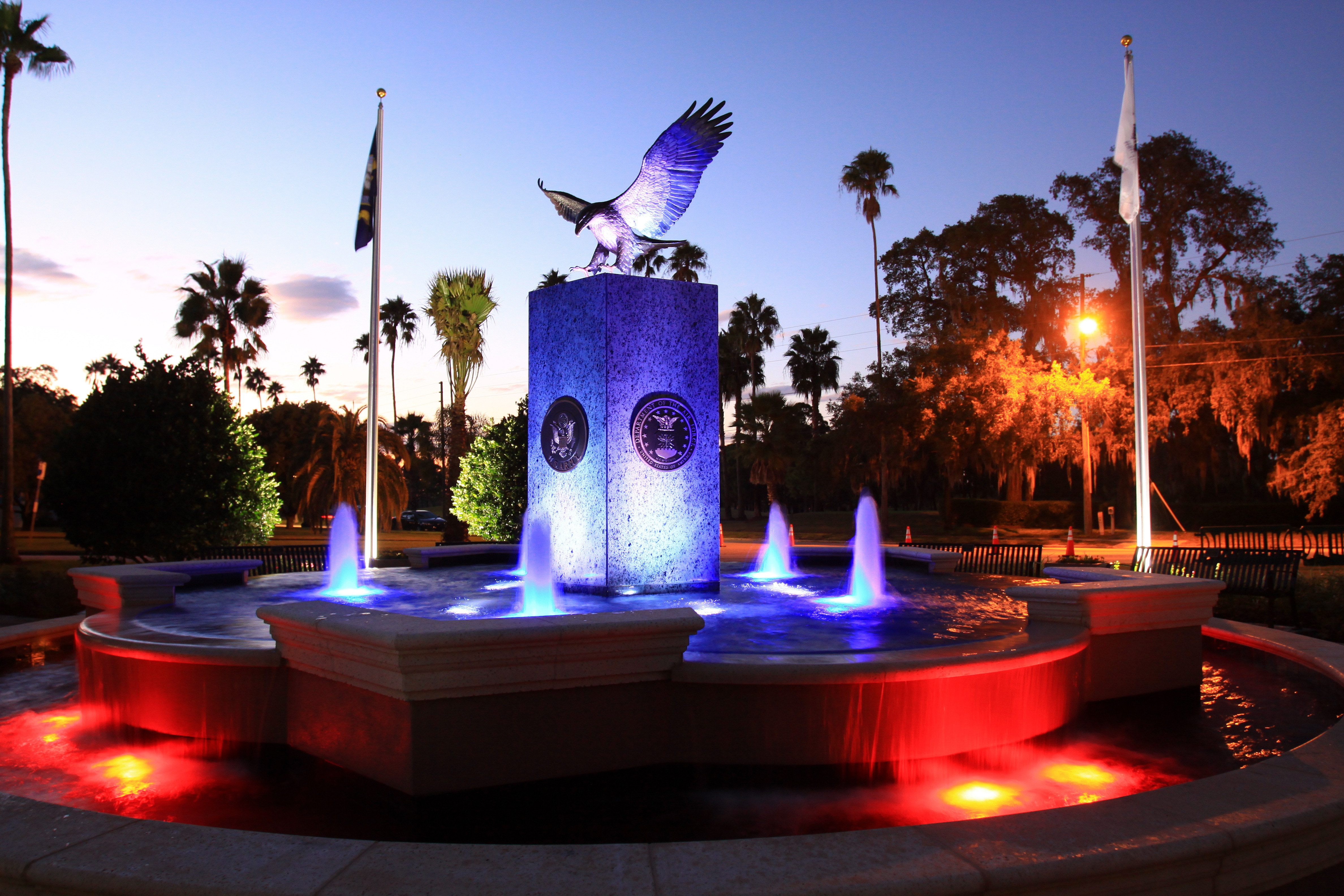 Hunter Memorial Park's fountain at sunset with fountain lights shining up on it