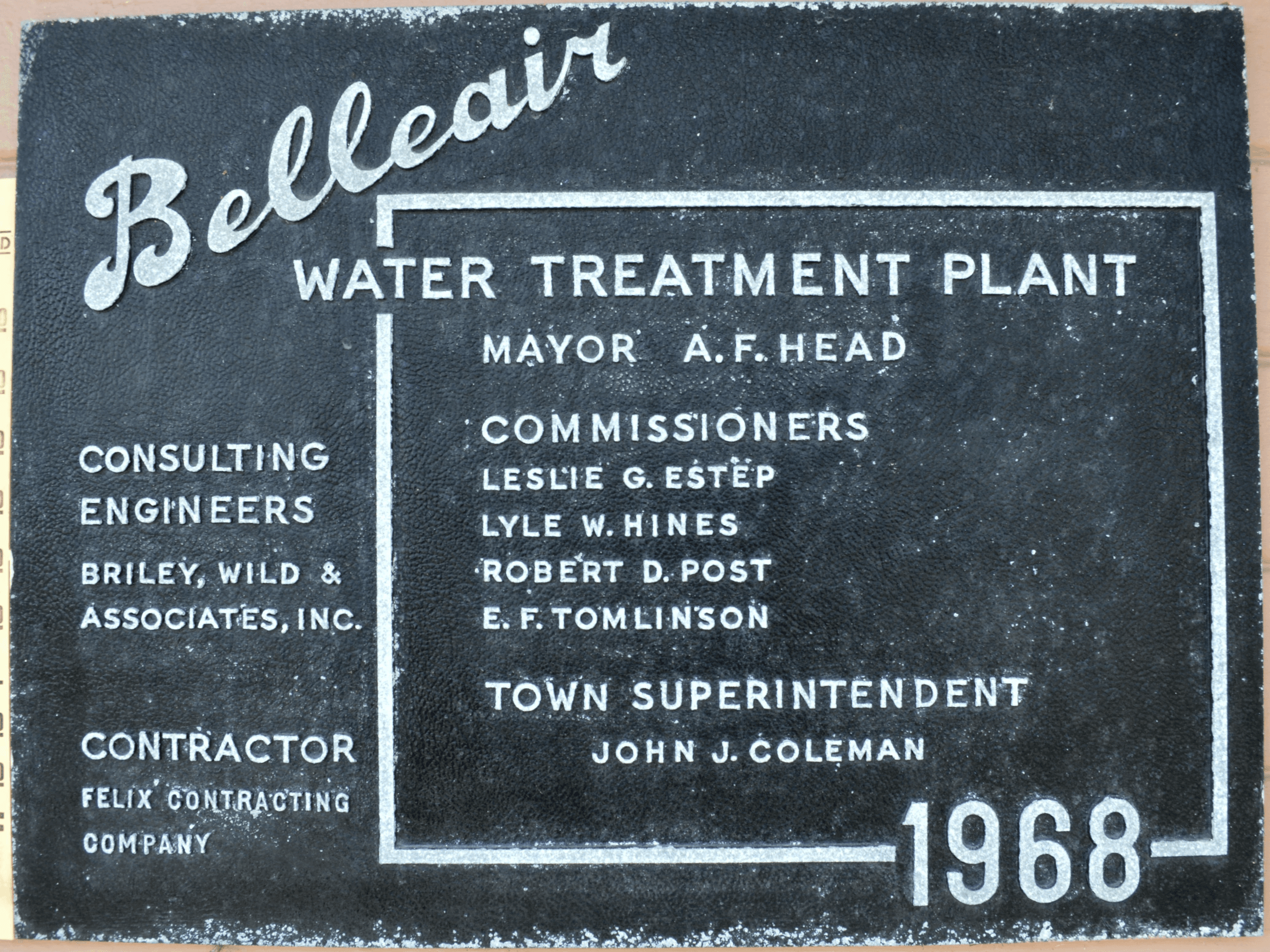 Dedication plaque hanging outside of Belleair's water plant.