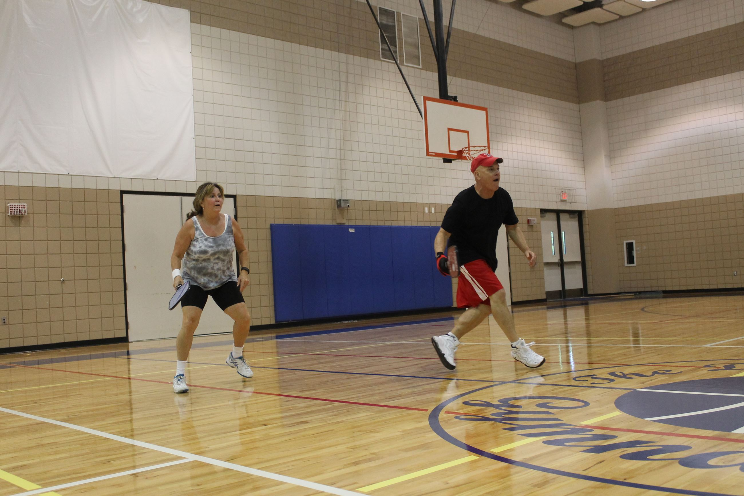 Two players playing pickleball