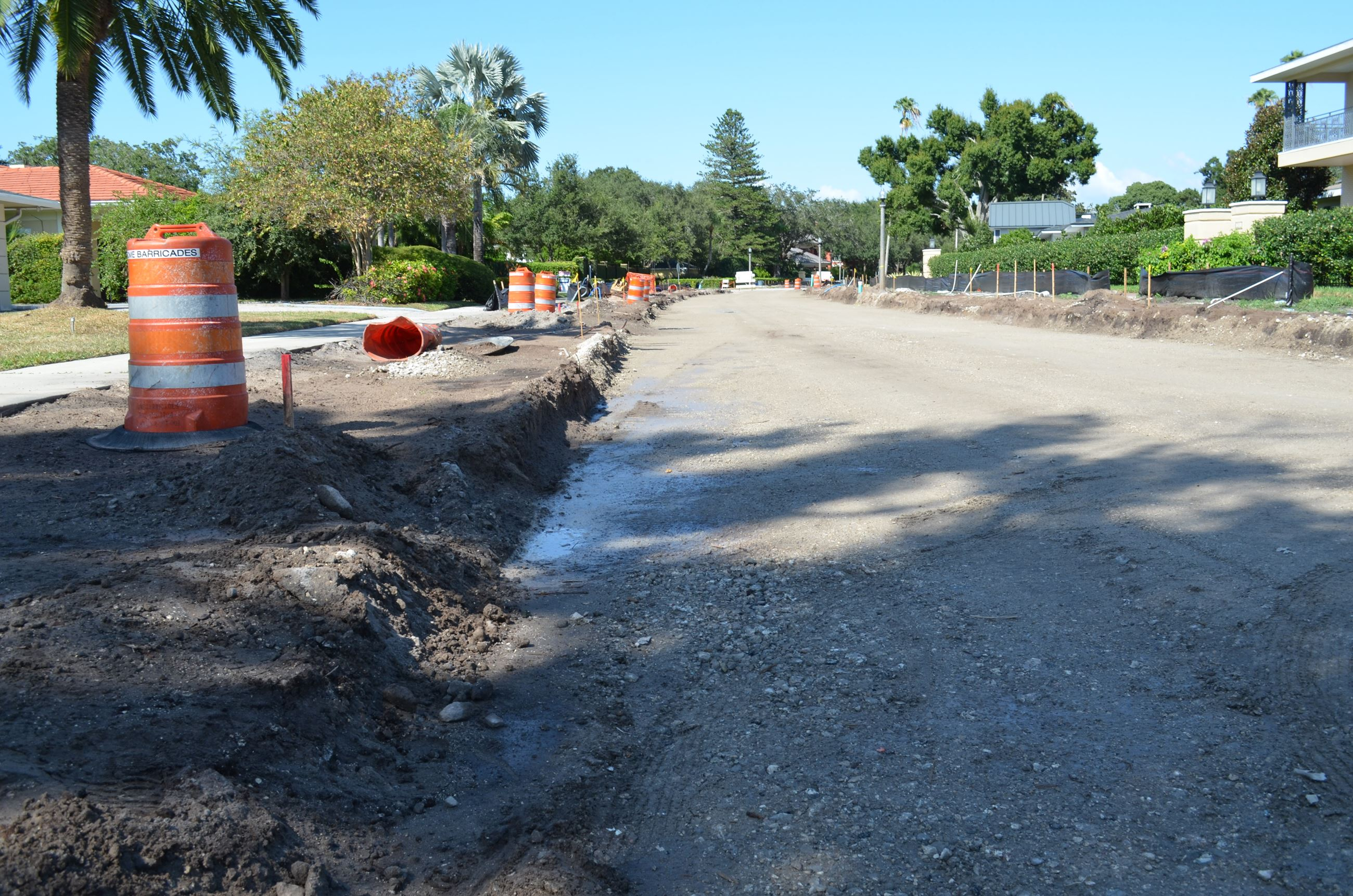 A view of Palmetto Road where road base and curbs are removed and dirt is in its place